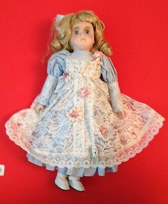 Bisque doll blue and white lace dress vintage looking with blond hair blue eyes