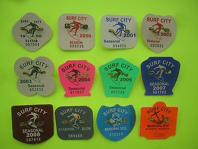 12  Year  Collection  Of  Surf   City,  New  Jersey Seasonal Beach Badges/tags