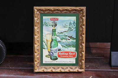 Vintage Rollling Rock advertisement sign with embossed plastic frame. 1970's.