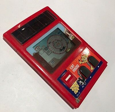 Cat Hand   Casio   1983   CG-32   Vintage LCD Electronic Handheld Game (ch)