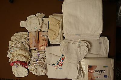 Bundle of re-useable nappies, covers, liners and nippas (new and used)