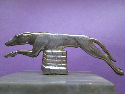 Art Deco gray marble with Greyhound from white metal