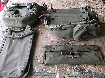 4 US Military Pouches - for Supply and Safety Gear - 1 is a Rifle Cleaning Kit.