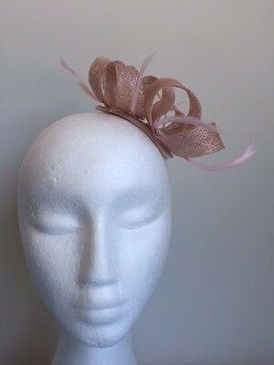 Cute pink loop fascinator with feathers on a clear comb. Gorgeous on!