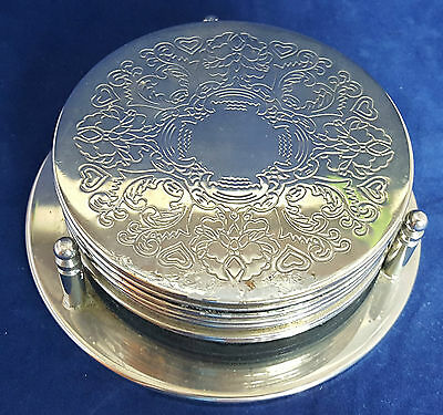 Beautiful Set of 7 Silver Plated Coasters with Stand.