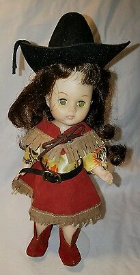 Vintage Ginny doll in cowgirl outfit with stand