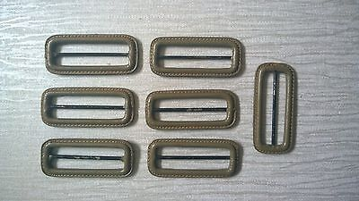 7 vintage Leather covered buckles khaki green