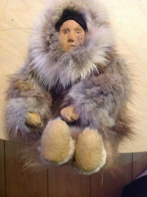"A vintage 9"" Eskimo Doll Woman Carrying  A Baby"