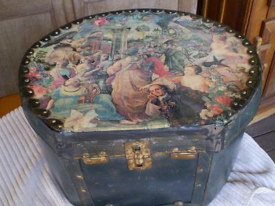 Vintage old hat box with print on top and on sides great decorater prop as found