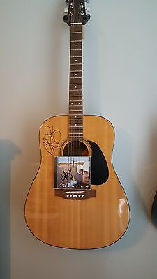 Guitar Autographed by Brad Paisley and matching signed CD