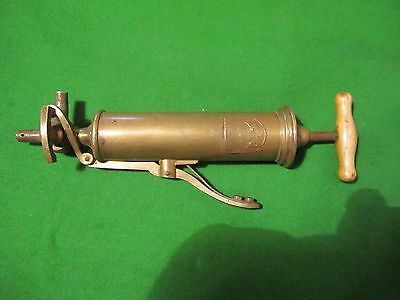 rare antique brass medical pump with unusual dual outlet