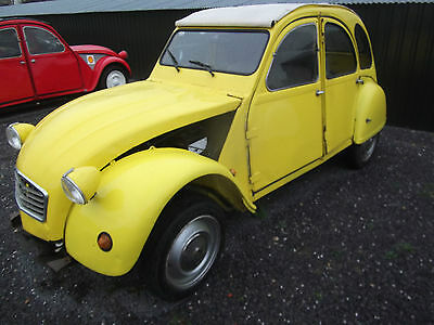 Citroen 2cv(yellow) for light re-commissioning. Solid with good chassis.LOOK