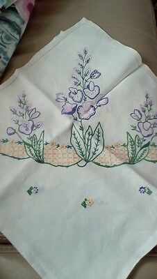 Vintage hand embroidered tablecloth. Lilac flowers.