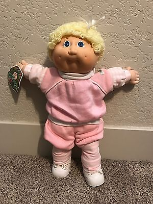Cabbage Patch Kid Blonde Hair, Blue eyes, pink outfit, with birth certificate!