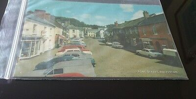 Old postcard. Fore street dulverton vintage cars hardware shop salmon cameracolo