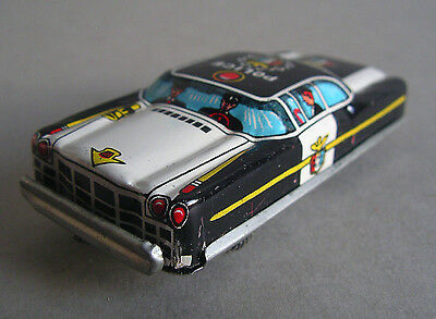 T.N. NOMURA Made in Japan Cadillac Police Car Vintage Friction Tin Toy Car 1960s