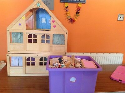 large wooden dolls house and loads of wooden furniture