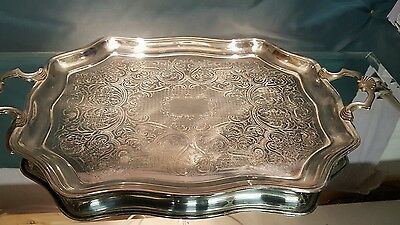 A large vintage silver plated serving tray made in england