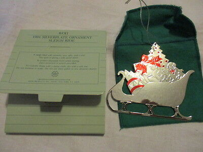 "AVON 1991 Silverplate Ornament ""Sleigh Ride"" Comes in Green Pouch 3"" T x 3 1/2""W"
