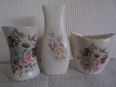 PURBECK POOLE VASES (3) with floral design. Very good condition