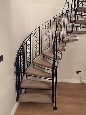 Wrought iron spiral staircase with landing banister