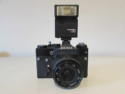 A vintage Russian Zenit 35mm camera with lens and additional flash