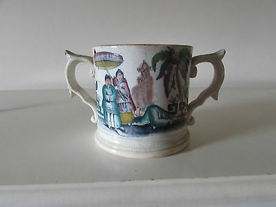 A 19th century creamware china two handled loving cup