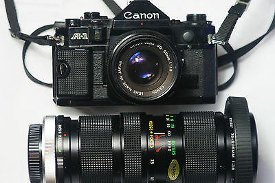 Canon A-1 35mm SLR Film Camera with 50 mm lens and Vivitar Zoom 75-205 Lens