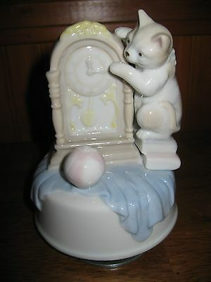 Vintage Glazed Porcelain Rotating Cat  Musical Figurine / 5  inches tall.