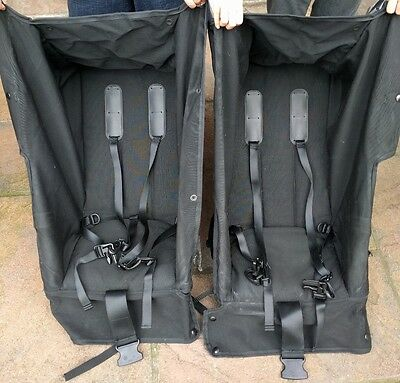 Spare set of black seating and hood canopy for mountain buggy urban double.
