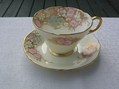 Rare Cream Paragon Cup & Saucer W/Baskets Of Florals Backed By Lavish Gold