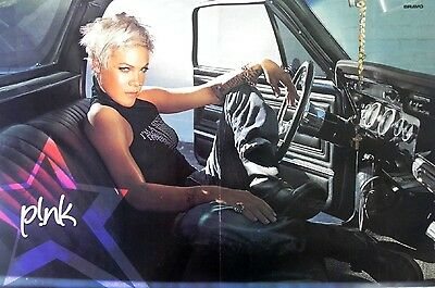 Pink magazine Poster in car + T.I. Poster