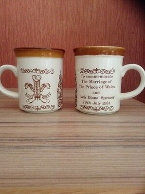 Two Prince Charles & Lady Diana Marriage Commemorative Mugs.