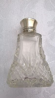 A Silver Topped Decorative Glass Scent Bottle by G.E.W