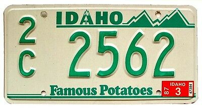 "Idaho 1987 ""Famous Potatoes"" Canyon County License Plate, Green-White, Mountains"