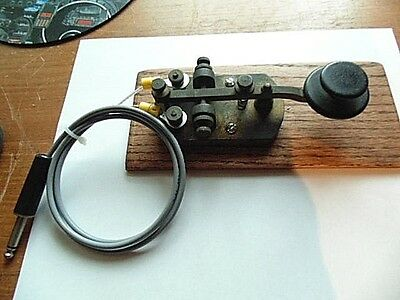 Vintage Morse code key with base and cable. ham radio
