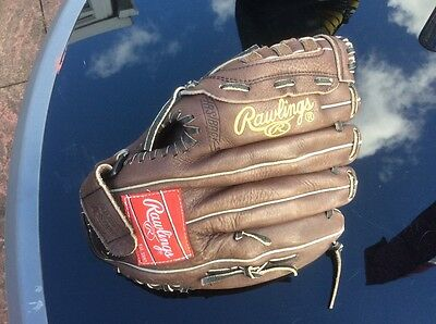 Tanned leather Rawlings right handed baseball glove
