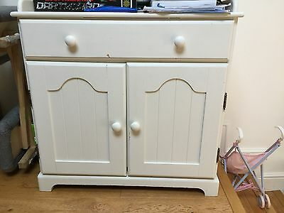 Cupboard with drawer and changing station