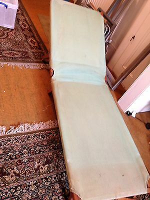 Vintage wood and canvas folding camp bed.