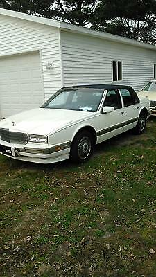 1990 Cadillac Brougham  1990 Cadillac Seville