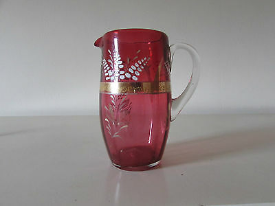 A 19th century Cranberry glass hand painted tapered jug