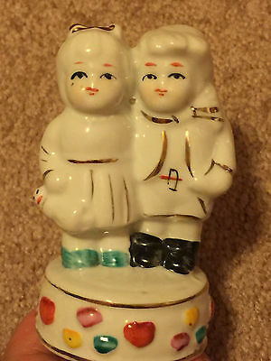 """Vintage 4"""" boy and girl porcelain figurine. Asian red stamp on the bottom."""