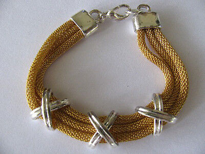 THREE ROWS of GOLD PLATED MESHED STYLE w/SILVER DESIGNS LINKED BANGLE BRACELET