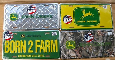 4 New Sealed John Deere  License Plates Made In USA .....FREE SHIPPING ALSO