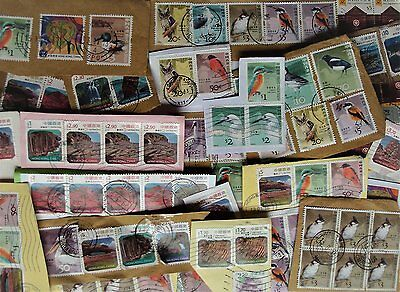 Pack of over 100 used stamps, all from Hong Kong, on paper