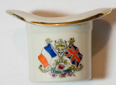 Top hat match holder, crest of Franco / British 1909 Exhibition in London