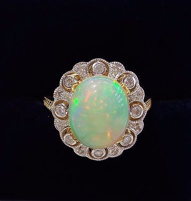 Natural Opal Ring with Diamond Surround in 18ct Yellow Gold - Size N