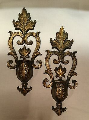 Vintage 1970 Sexton cast iron wall sconces. Black and gold. Hollywood regency.