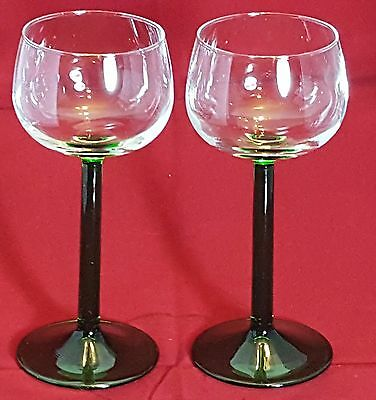 A pair of beautiful Green Glass Wine Glasses.