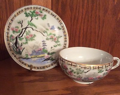 Vintage Japanese Porcelain Cup and Saucer With Temples And Cherry Blossoms